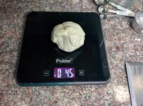 Weighing out one-eighth of the dough.