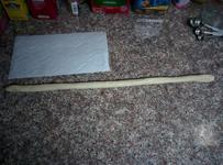 Using a paper towel as a length reference — it's eleven inches long.
